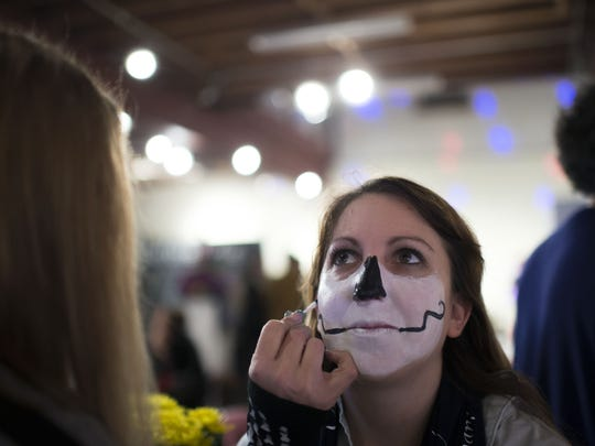 Rebecca Muller has her face painted at the #BeforeIDie event at Perkins Center For The Arts by Elizabeth Houghton.