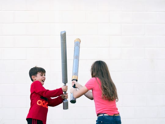 Children at The Ellison School play with foam swords as part of the school's medieval event Wednesday afternoon in Vineland.