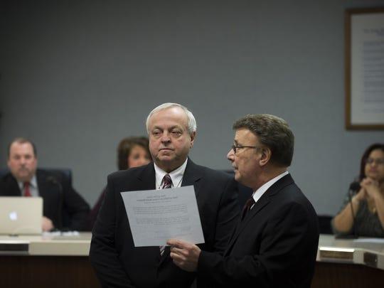 F. John Sbrana, left, is sworn in as a new member of the Vineland Board of Education Wednesday, Jan. 6 in Vineland.