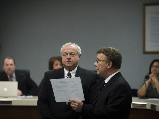 F. John Sbrana, left, is sworn in as a new member of