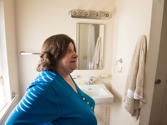 Sharon Walton, of Salisbury, talks about her handicap accessible bathroom in her apartment on Tuesday Jan. 12, 2016.