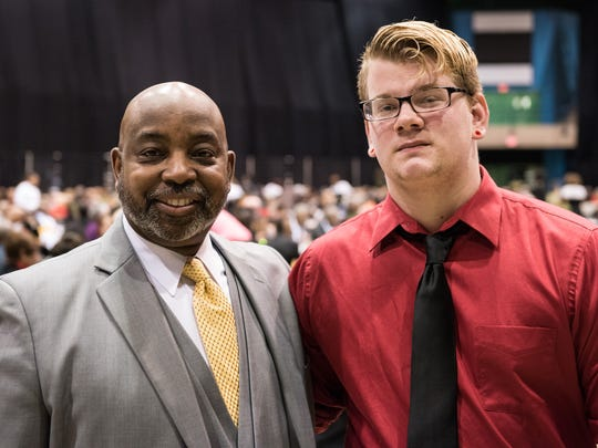 Mark Thompson, left, and Sean O'Dea, 18, pose for a photo during the 31st Annual Rev. Dr. Martin Luther King, Jr. Birthday Celebration and Commemoration Banquet at Wicomico Youth and Civic Center on Monday Jan. 18, 2016.
