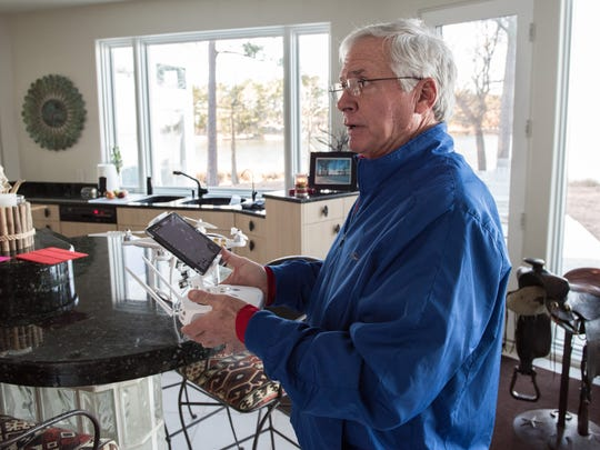 Dan Kuebler, of Crisfield, demonstrates the iPad control panel he uses with his DJI Phantom 3 quadcopter on Thursday Jan. 14, 2016.