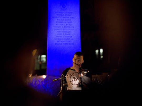 Brett McCormick tells stories of fallen State Trooper Sean Cullen as community members, friends and family gather for a vigil Thursday night, March 10 in Westampton.