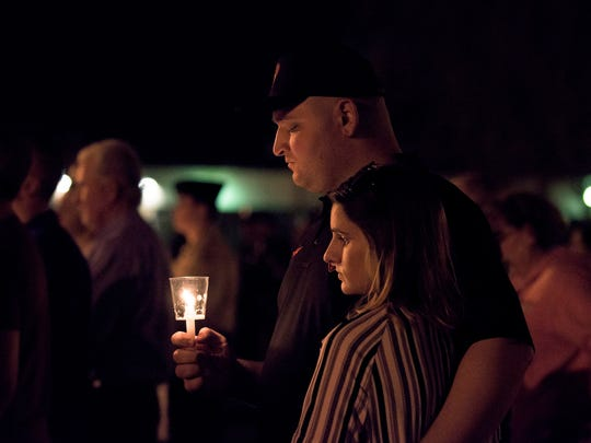 Community members, friends and family gather for a vigil honoring faller New Jersey state trooper Sean Cullen Thursday night, March 10 in Westampton.