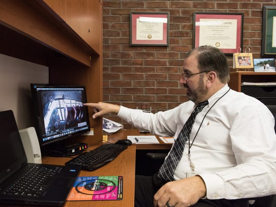 Somerset County Public Schools Superintendent, John Gaddis, reviews the footage of the crash at his Tawes Campus Drive office on Tuesday, March 8, 2016.