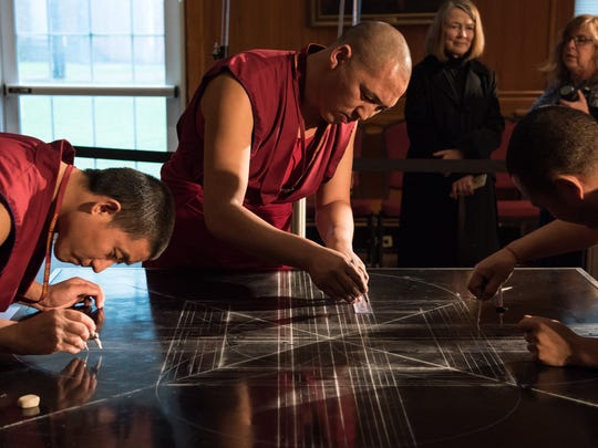 Tibetan Buddhist Monks from the Drepung Loseling Monastery of India prepare a Mandala Sand Painting at Salisbury University on Tuesday, April 12, 2016.