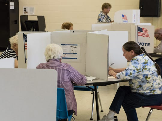 A group of residents from Wicomico County place their primary vote at Parkside High School on Tuesday, April 26, 2016.