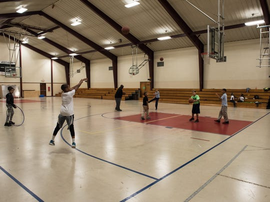 Children from the community play basketball at the Salvation Army Youth Club gymnasium on Wednesday, May 4, 2016.