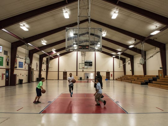 Children from the community play basketball at the
