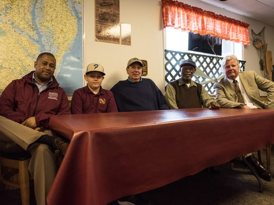 From left, Berran Rogers, Jacob McFarland, Richard Evanusa, Arthur Allen, and Eric May pose for a photo at Beach to Bay Seafood Company in Princess Anne on Tuesday, May 10, 2016.
