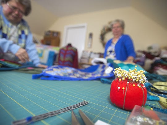 Nancy Hastings organizes fabric in her Whaleyville home before the Quota International Christmas Gift and Craft show in Salisbury in 2014.