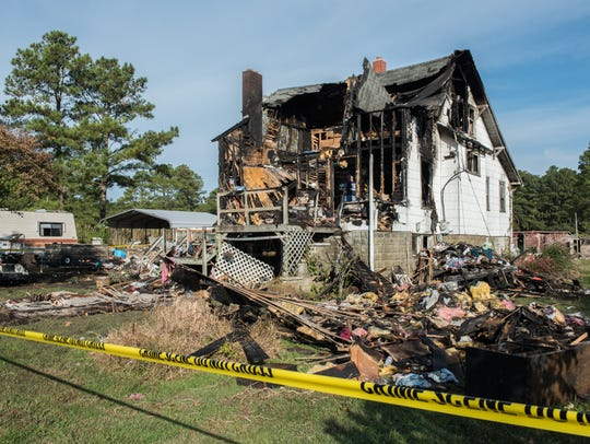 An exterior view of a house damaged by fire on Johnson