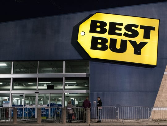 Three people line up outside of Best Buy on North Salisbury