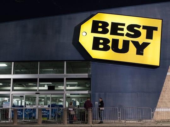 Three people line up outside of Best Buy on North Salisbury
