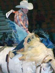 Rollie Wilson of Buffalo, South Dakota, rides a bucking horse in the 2010 Amicus Club Rodeo at the Rapides Parish Coliseum.