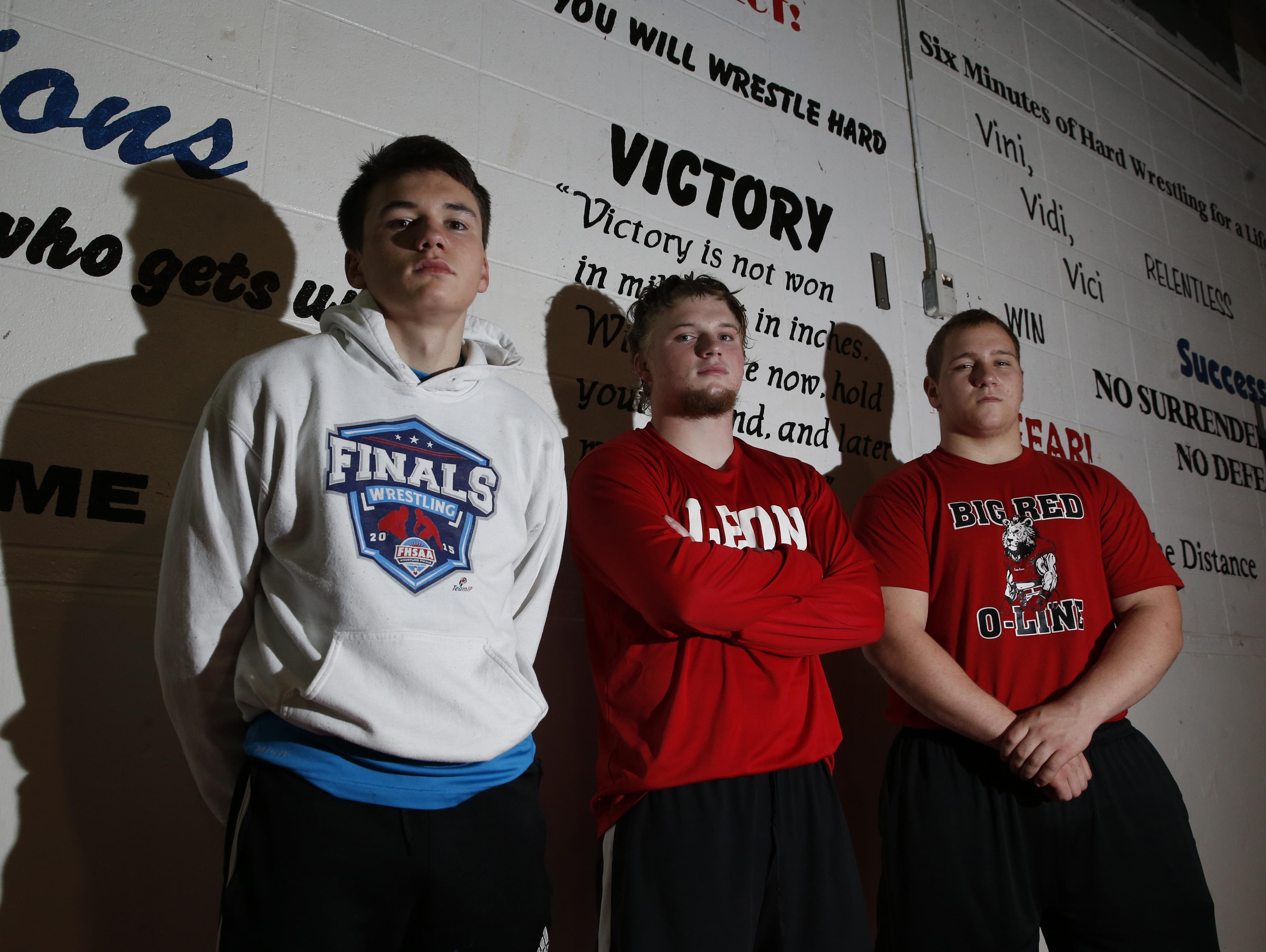 The Leon wrestling team returns three state-qualifying wrestlers off a 12th place state finish: from left, sophomore brothers Justin Grant (155) and J.T. Grant (220), and heavyweight state runner-up Gabe Beyer.