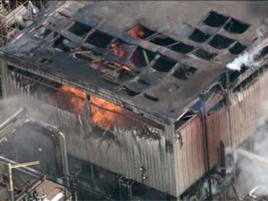 Firefighters in 2015 battle flames in a building at the Delaware City Refinery.
