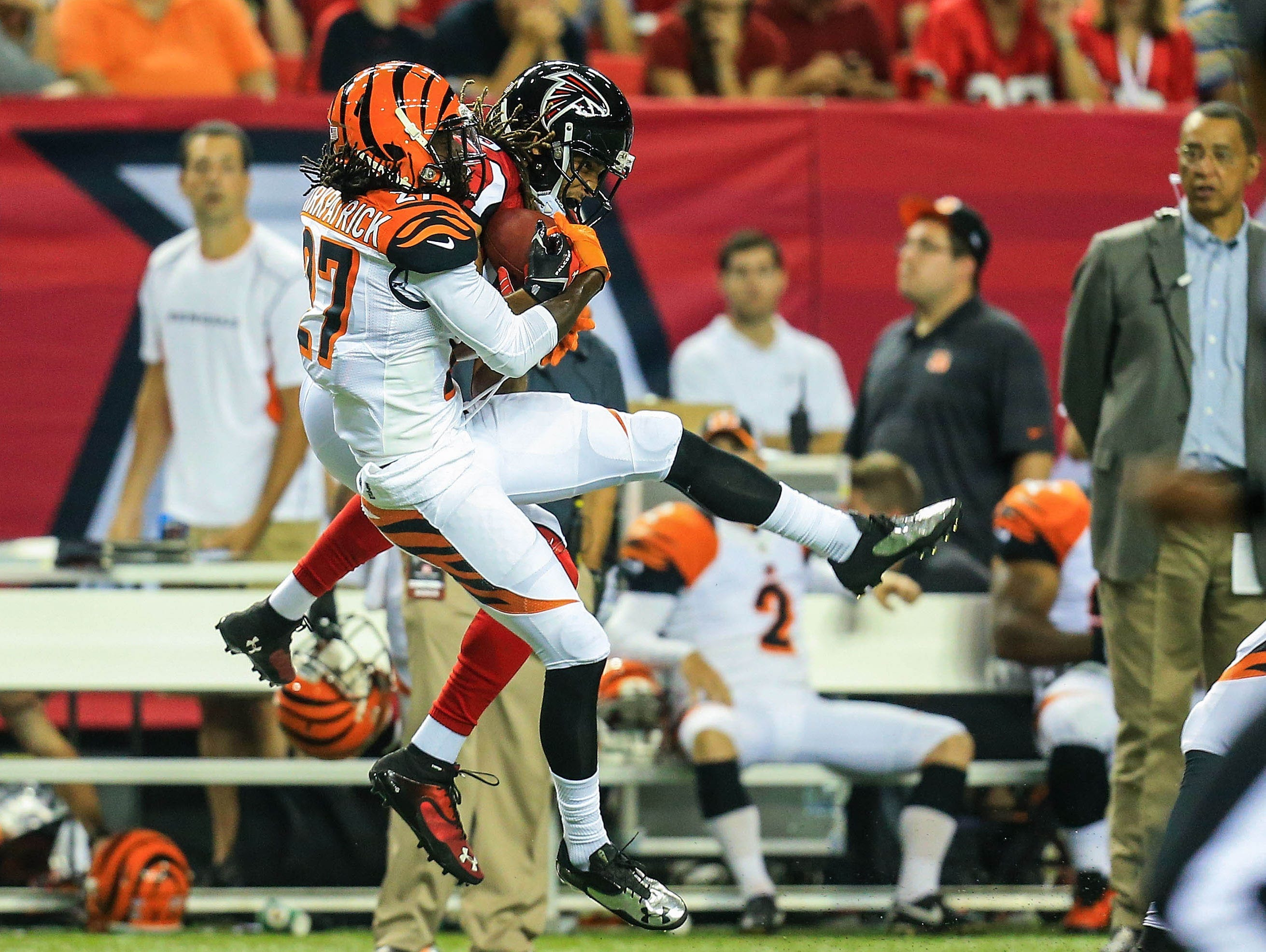 Cincinnati Bengals cornerback Dre Kirkpatrick (27) breaks up a pass intended for Atlanta Falcons wide receiver Kevin Cone (15) in the first half at the Georgia Dome.