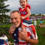 Windsor resident Tom Brown and one year old Madison Collier  show their patriotic colors Saturday as they celebrate the 4th of July at Boardwalk Park.
