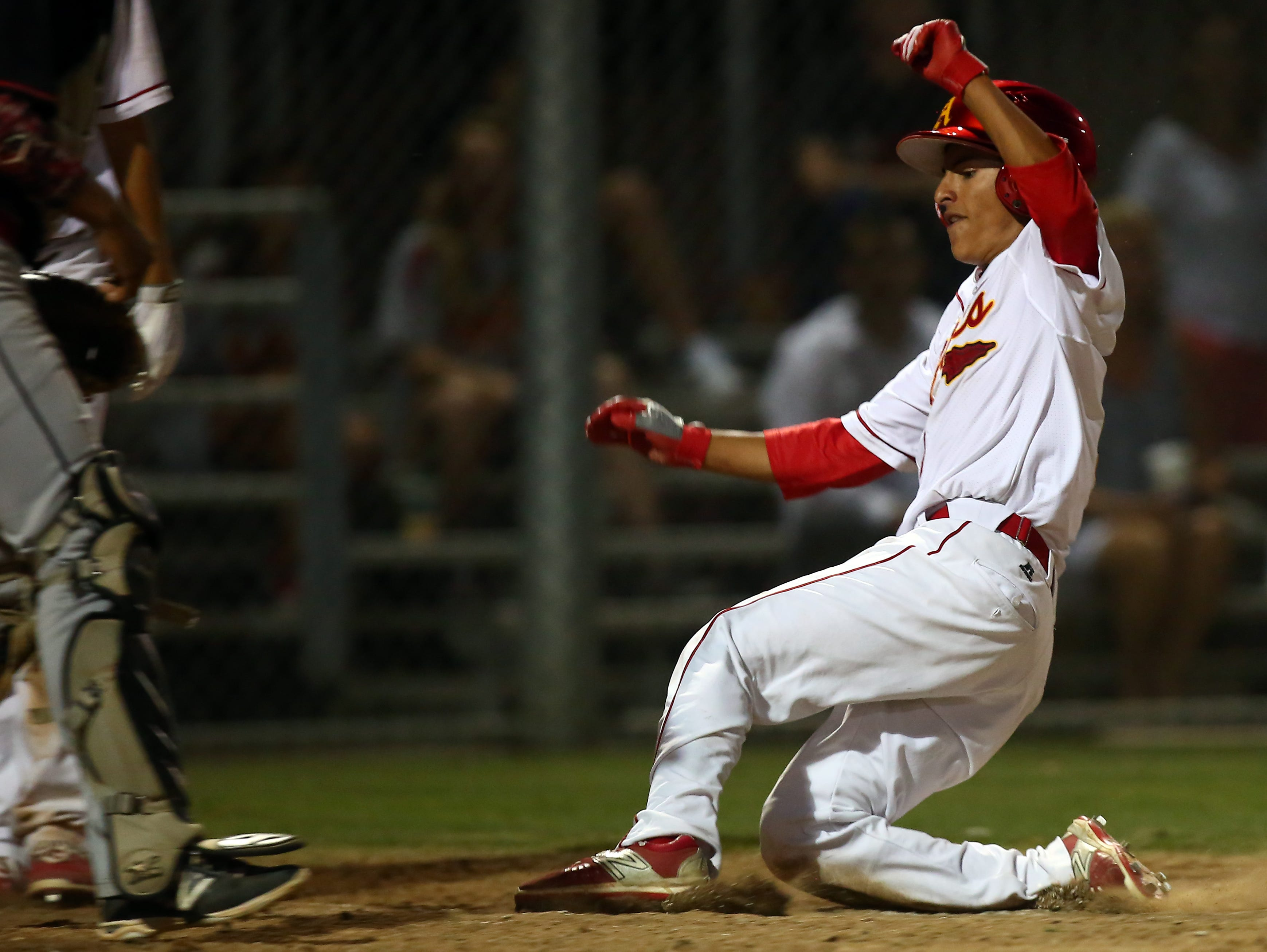 Palm Desert's Joshua Hernandez (1) steals home as the Aztecs host the Palm Springs Indians at home Tuesday, April 5, 2016.