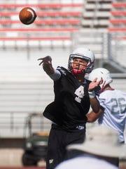 Austin Ewing (4) runs drills during practice at Eccles