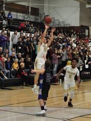 Abilene High's Nic Marczynski shoots a 3-pointer over
