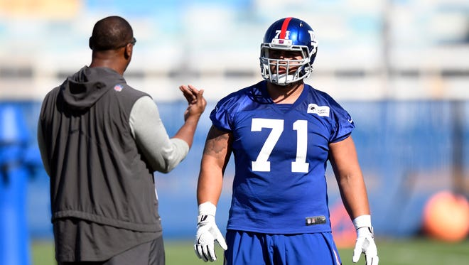 New York Giants guard Will Hernandez (71) talks to assistant offensive line coach Ben Wilkerson during the team's rookie minicamp in East Rutherford, NJ, on Friday, May 11, 2018.