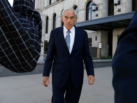 Former Republican presidential candidate Ron Paul walks