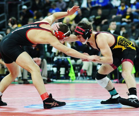 Roosevelt's Brock Kortan (right) wrestles Brandon Valley's Conner Rowbotham at 138 pounds Friday at the Class A state tournament. Kortan won by a 10-0 decision.