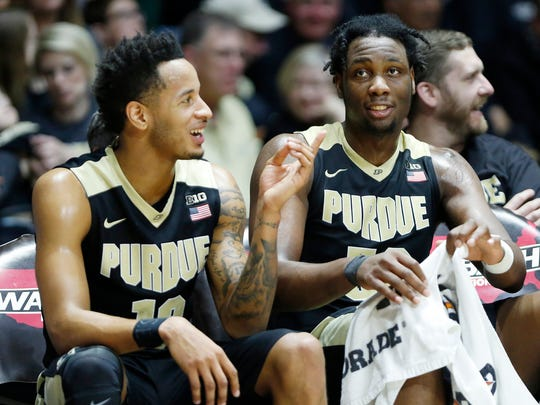 Vincent Edwards and Caleb Swanigan watch the final seconds tick off the clock against Michigan State Saturday, February 18, 2017, at Mackey Arena. Purdue defeated Michigan State 80-63.