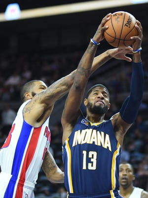 Jan 3, 2017; Auburn Hills, MI, USA; Indiana Pacers forward Paul George (13) goes to the basket and is fouled by Detroit Pistons forward Marcus Morris (13) during the first quarter at The Palace of Auburn Hills.