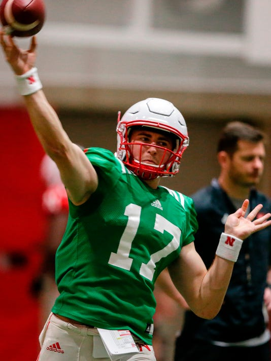 FILE - In this April 3, 2018, file photo, Nebraska quarterback Andrew Bunch (17) throws during NCAA college football spring training in Lincoln, Neb. Spring practice is just past the midway point at Nebraska, and new coach Scott Frost is beginning to flesh out a quarterback pecking order. (AP Photo/Nati Harnik, File)