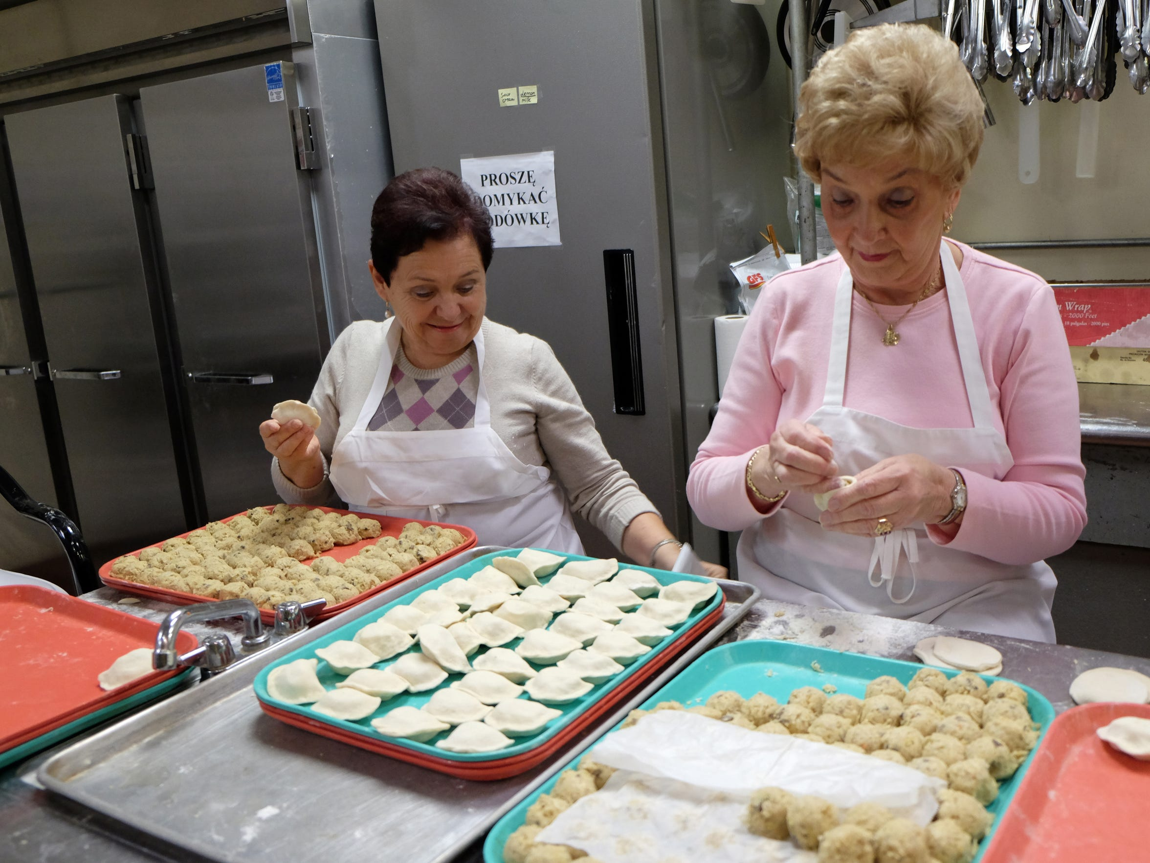 Maria Rokita, left, and Janina Stanton make sauerkraut pierogi at the American Polish Cultural Center.
