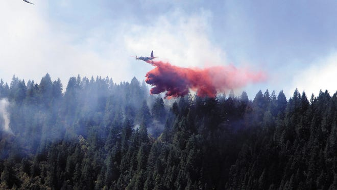 An aerial tanker and guide plane make a pass near Rattlesnake Creek in Glendale on July 28, 2013.