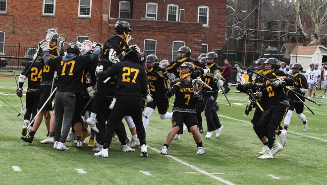 Cedar Grove's boys lacrosse team celebrates after Nick LoPresti's game-winning goal in double overtime against Nutley.