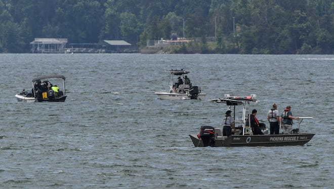 Anderson Technical Rescue, Pickens County, Greenville County, and South Carolina Department of Natural Resources search boats look near Broyles Landing on Lake Hartwell in Anderson on Tuesday.