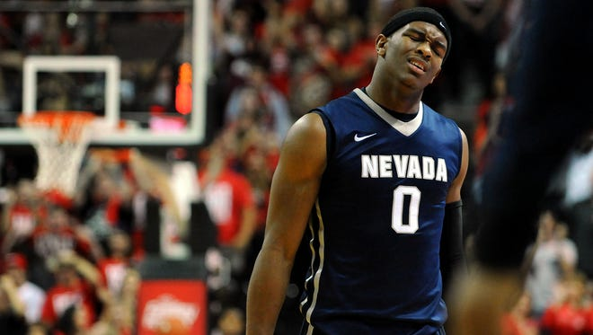 Wolf Pack forward Cameron Oliver reacts as he walks to the bench at the end of regulation during Nevada's loss at UNLV on Saturday night.