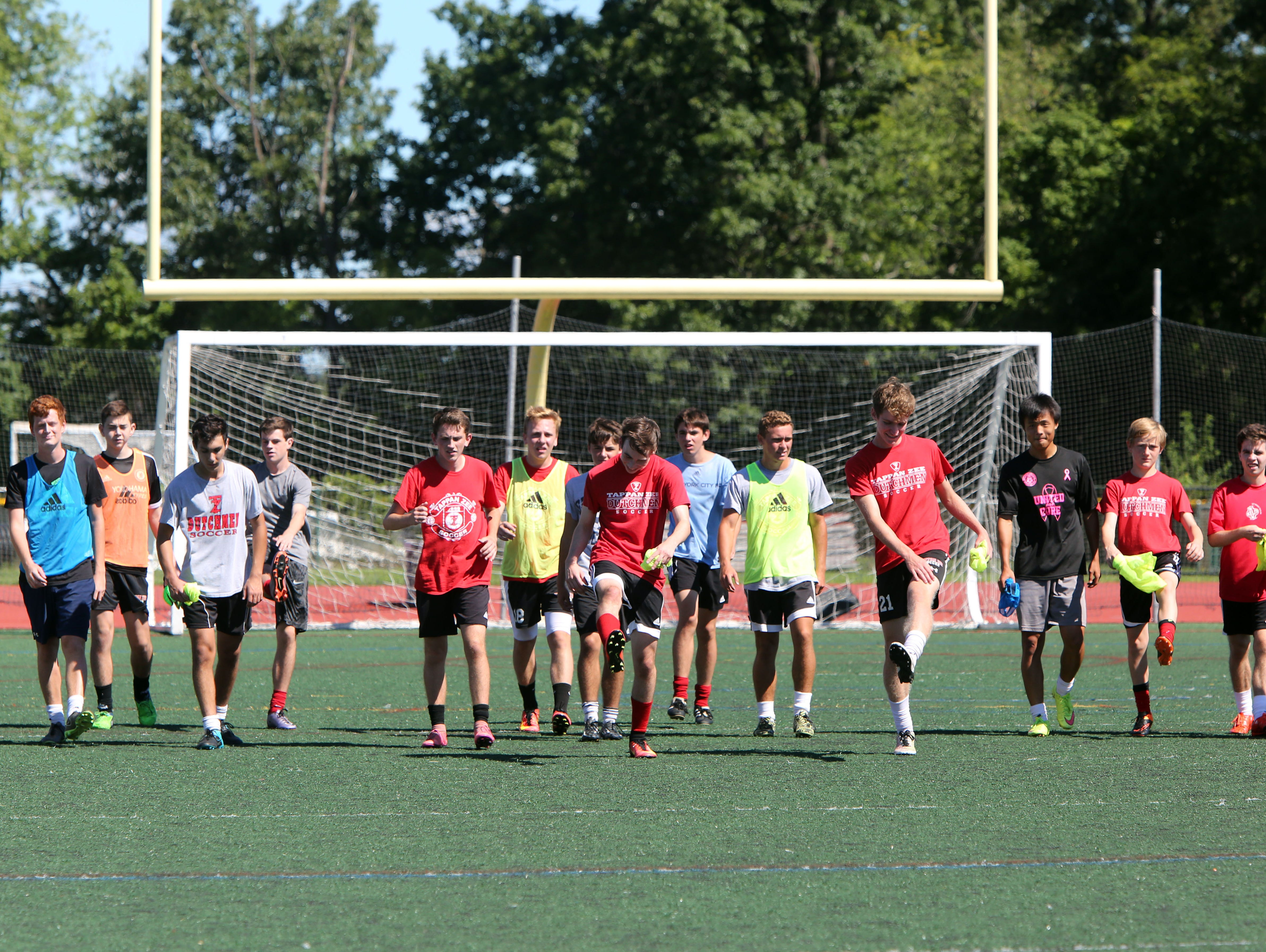 Players cool down after the morning session of the first day of soccer practice at Tappan Zee High School Aug. 22, 2016.