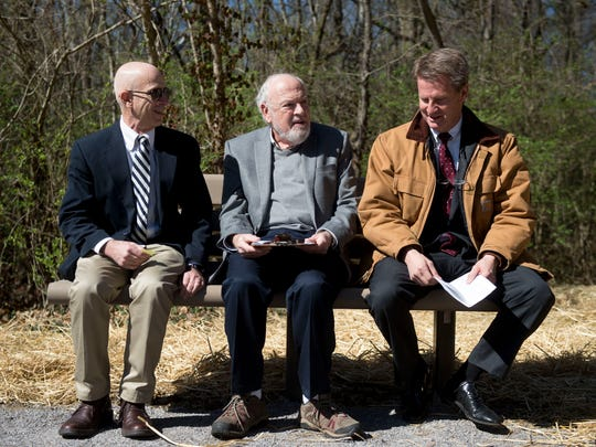 Bill Lyons, chief policy officer and deputy to Mayor Madeline Rogero, left, and Knox County Mayor Tim Burchett, right, sit with retired University of Tennessee archeologist Charlie Faulkner on Thursday, March 2, 2017 during a dedication ceremony at the site of a Civil War fort that was discovered along the Third Creek Greenway. The small fort, also called a redan, was discovered by Faulkner in 2006.
