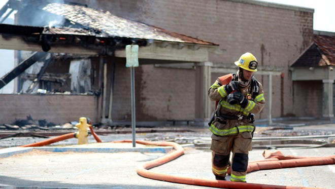 CAL FIRE battalions including 49 individual firefighters respond to a commercial structure fire on Thursday, May 7, 2015 in Indio.
