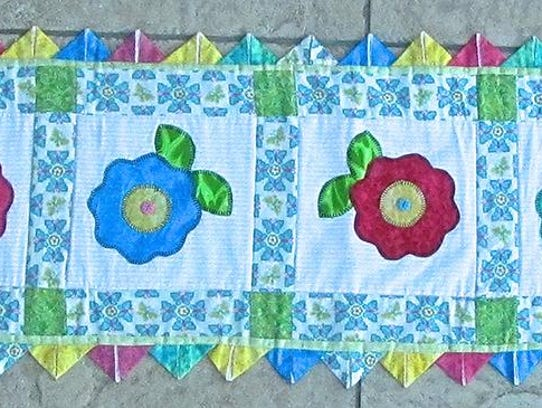 "Sewn art by Vivian Hannan, part of the ""Startings"""