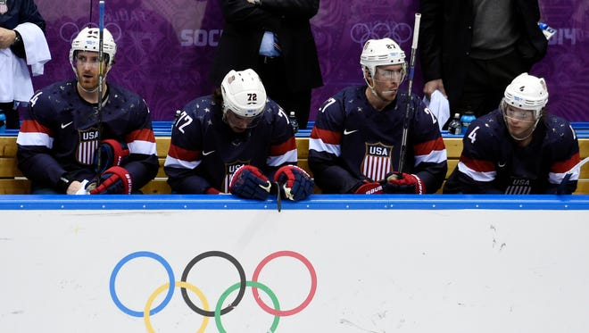USA players react on the bench in the third period against Finland in the men's ice hockey bronze medal game.