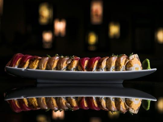 October 22, 2017 - The Sexy Lady includes shrimp tempura, avocado, white and Cajun tuna, ponzu, rice and Sriracha at Sakura Japanese Restaurant located at 4840 Poplar Ave.