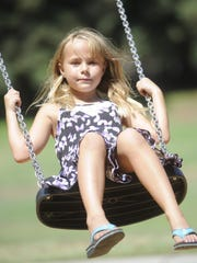 Maddie Polzien spends a day at the park with her mom.