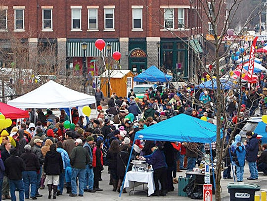 A crowd of people at the Vermont Chili Festival in