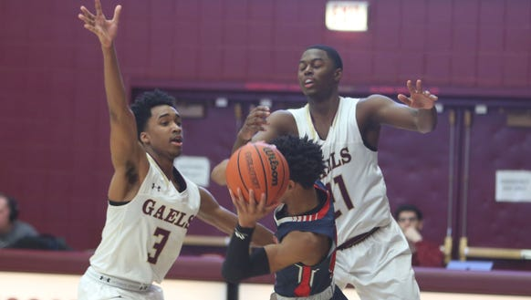 Iona Prep's Bryce Wills (3) and Josh Alexander (21)