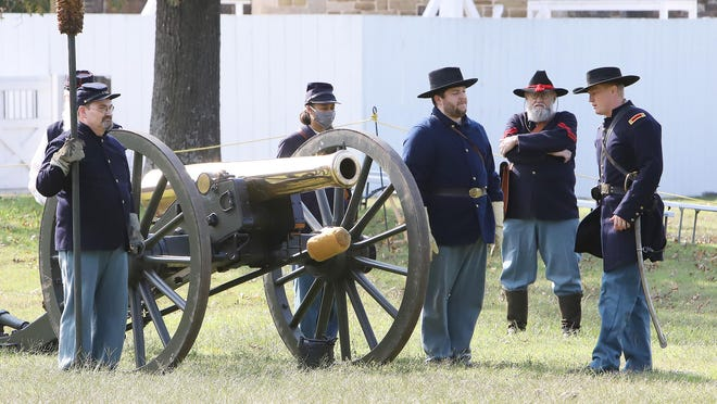 Dressed as a Union artillery officer, Cody Faber, right, works with volunteer living historians to reenact cannon fire on Saturday during a demonstration at the Fort Smith National Historic Site. A Confederate artillery demonstration is scheduled for Oct. 17 at 11 a.m. and 2 p.m. and is open to the public.