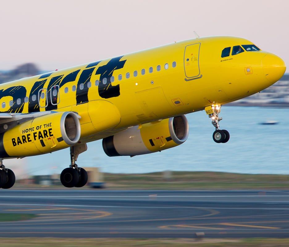 A Spirit Airlines Airbus A320 departs Boston Logan International Airport on Nov. 25, 2017.