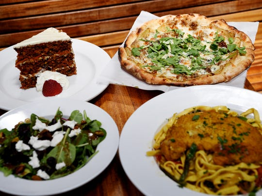 Clockwise from top left, West First Wood-Fire Pizza's carrot cake, potato pizza, Moroccan chicken and pasta, and house salad.